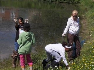 Students cleaning around their local pond!