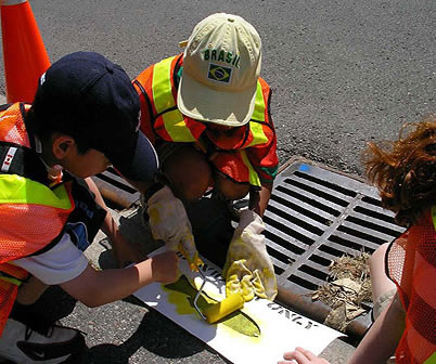 Gr. 4 students painting fish to mark storm drains